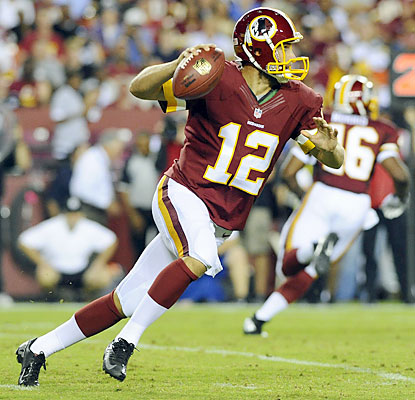 Redskins QB Kirk Cousins plays briefly before exiting for good with a sprained right foot. (USATSI)