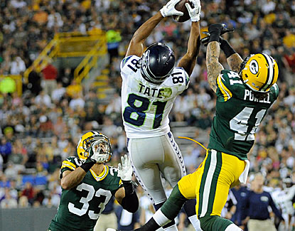 Seattle's Golden Tate goes up for the grab against the Packers' defense, his only reception in four chances. (USATSI)