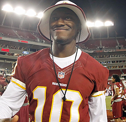 Robert Griffin III tweets that he is cleared to play in the Redskins' Monday Night opener against the Eagles.  (USATSI)
