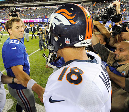 Peyton (right) throws for 307 yards and 2 TDs as he moves to 3-0 against Eli (362 yards, 1 TD, 4 INTs). (USATSI)