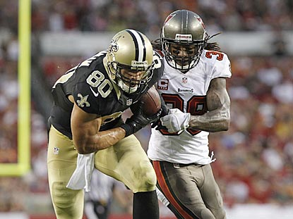 Jimmy Graham beats Dashon Goldson downfield during the first half. He finishes with 10 catches for 179 yards and a touchdown.  (USATSI)