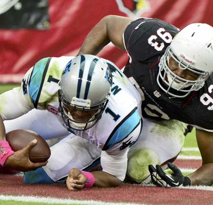 The Cardinals harass Panthers QB Cam Newton to the tune of three picks, a safety and seven sacks.  (USATSI)
