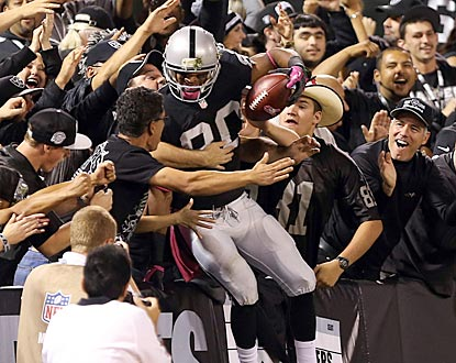 Rod Streater celebrates with Raiders fans after catching a touchdown pass on Oakland's first play from scrimmage.  (USATSI)