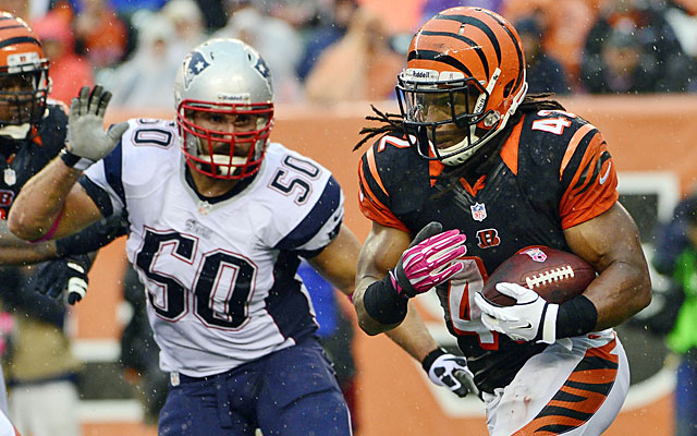 The Bengals took advantage of the big hole in the middle of the Patriots defense, rushing for 162 yards. (USATSI)