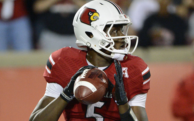 With 26 NFL scouts in attendance, Bridgewater helps his stock as a potential No. 1 pick. (USATSI)