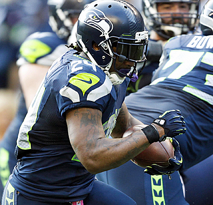 Marshawn Lynch leads the otherwise sloppy Seahawks with a pair of TDs, as Seattle knocks off the Titans.  (USATSI)