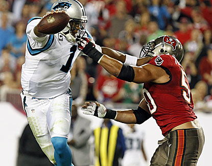 Cam Newton is a large man but his speed makes him an elusive target for Tampa Bay. He runs for 50 yards on 11 carries. (USATSI)