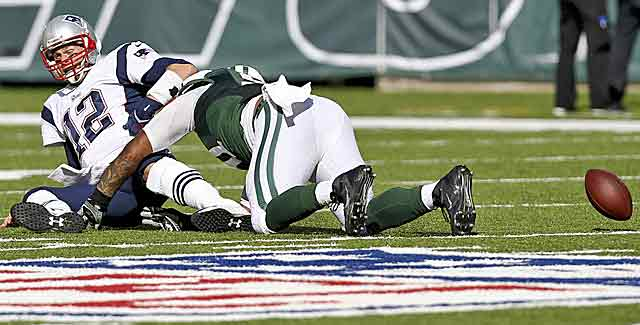 Tom Brady has spent considerable time getting up from sacks like this against the Jets. (Getty Images)