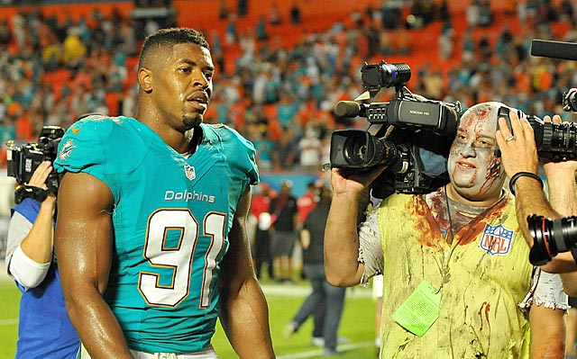 Cameron Wake and Dolphins prevail on Halloween with a never-say-die attitude.