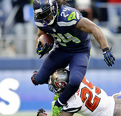 Marshawn Lynch rushes for 125 yards despite missing time in the first half, and the Seahawks escape.  (USATSI)