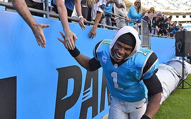 Cam Newton celebrates after leading the Panthers to their fourth win in a row.  (USATSI)