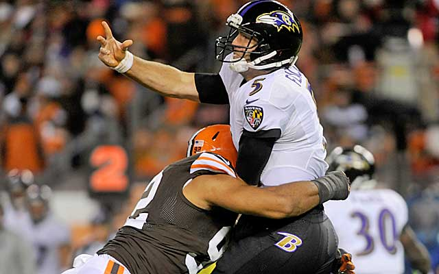 Joe Flacco continues to get pounded behind a struggling offensive line in Baltimore. (USATSI)