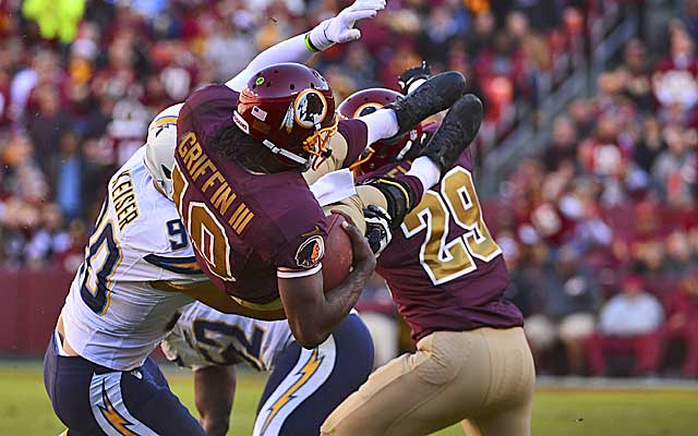 Robert Griffin III goes head over heels after taking a hit against the Chargers. (USATSI)