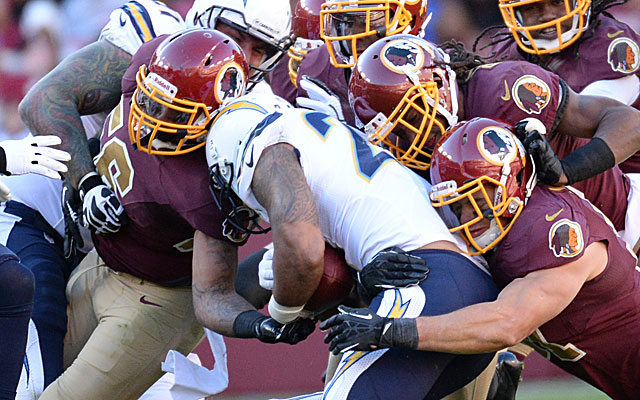 The Chargers' Ryan Mathews is stuffed by Redskins defenders. (Getty)