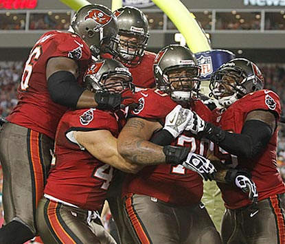 Teammates celebrate with Donald Penn after he catches a touchdown pass on a tackle-eligible play to open the scoring.  (USATSI)