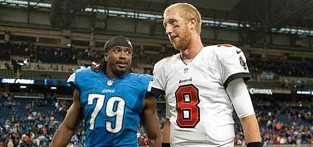 Basking in a third straight win, Mike Glennon walks off with Detroit's Willie Young. (USATSI)