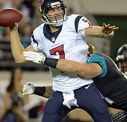 The Jaguars get after Case Keenum, who is eventually removed from the game in favor of Matt Schaub. (USATSI)