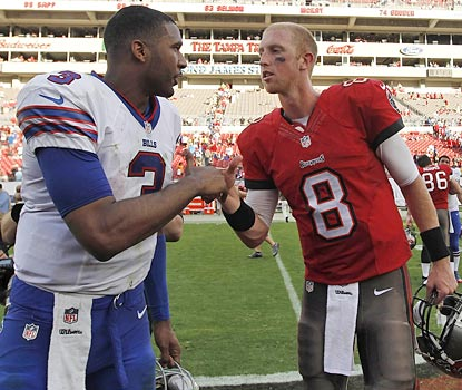 Mike Glennon (right) gets the best of this matchup of rookie quarterbacks.  (USATSI)