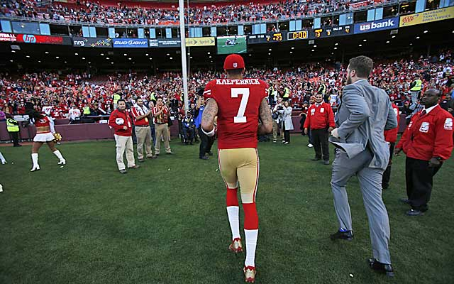 Colin Kaepernick leaves after a game vs. Seattle. The Niners play the final game at Candlestick on Monday. (Getty Images)