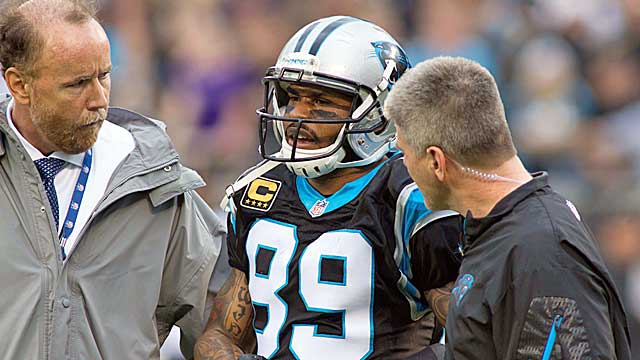 Medical personnel attend to Panthers wideout Steve Smith on Sunday. (USATSI)