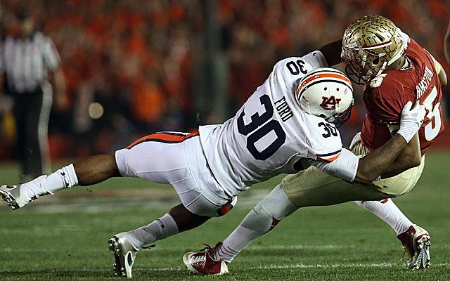 Auburn's Dee Ford sacks Florida State's Heisman-winning QB Jameis Winston. (USATSI)