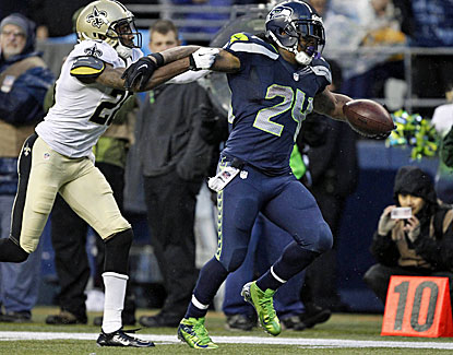 Marshawn Lynch breaks a tackle on his way to the end zone to help Seattle take down New Orleans. (USATSI)