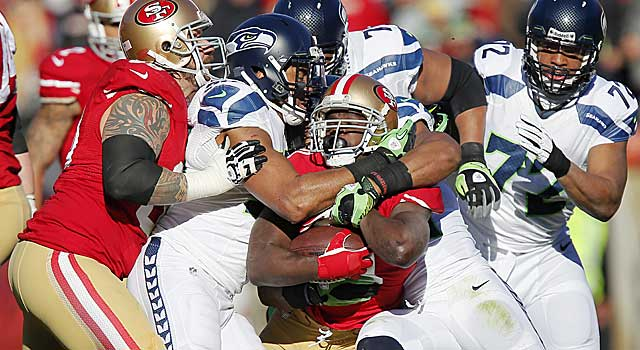 These NFC West rivals split two regular-season games, each an extremely physical affair. (Getty Images)