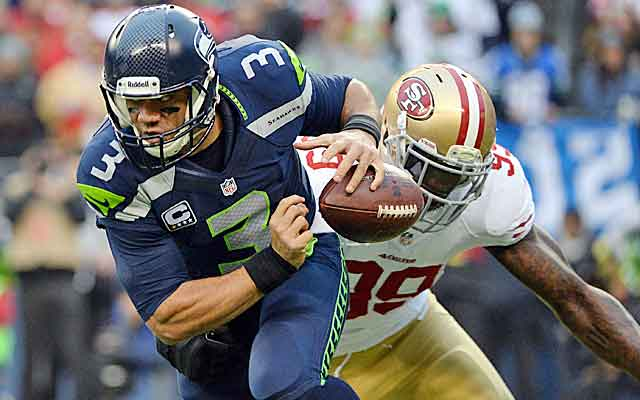 Can the Seahawks do a better job of protecting Russell Wilson against the Broncos?   (USATSI)