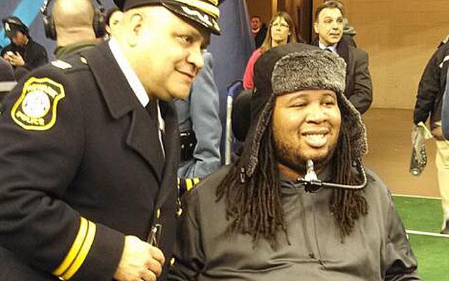 Eric LeGrand poses with Newark Police Capt. Felipe Gonzalez. (Gregg Doyel photo)