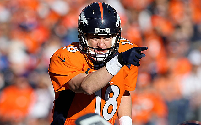 Peyton Manning gets a better grip on the ball wearing the glove. (USATSI)