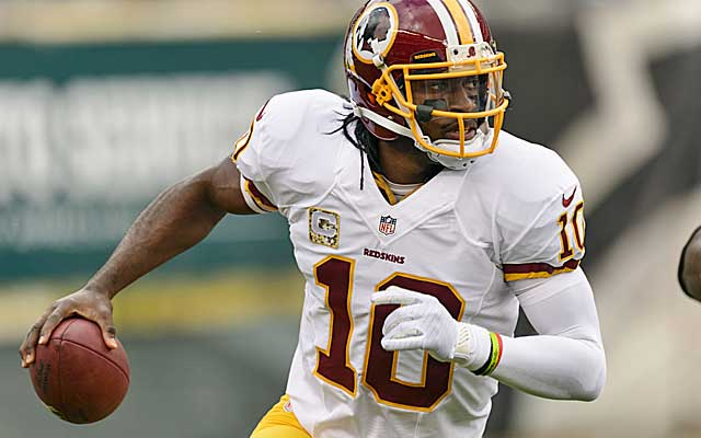 The honeymoon is over for RG3 and the Redskins.    (USATSI)