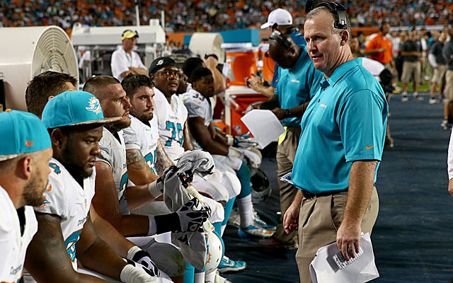 Dolphins OL coach Jim Turner denied knowing of a 'Judas fine' for snitches. (Getty)