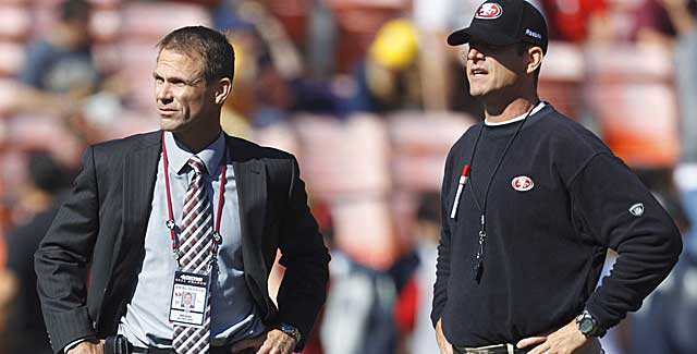 Niners GM Trent Baalke and coach Jim Harbaugh reportedly don't see eye to eye. (USATSI)