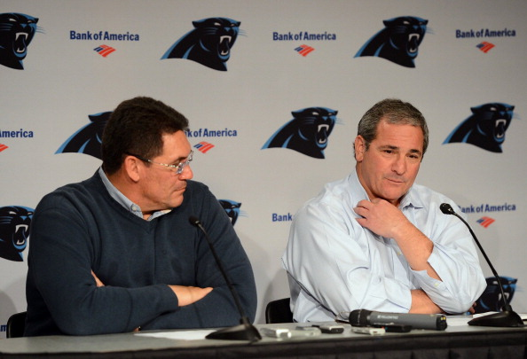 Gettleman (right) with coach Ron Rivera in January after an impressive season. (Getty Images)