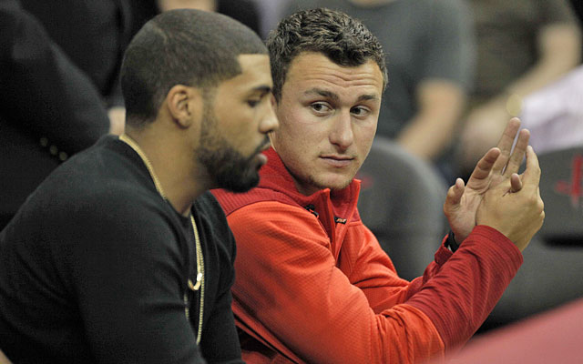 Hello, Houston -- Johnny Manziel got to hang out with Arian Foster at a recent Rockets game. (USATSI)