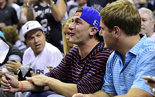 Johnny Manziel watches his pal LeBron James while sitting courtside during Game 2 of the NBA Finals.     (USATSI)