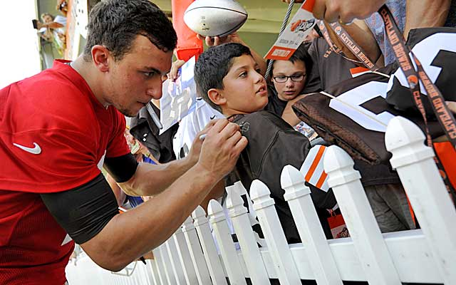 Manziel is a hit with the fans in Cleveland, but the Browns think his partying has affected his job performance.   (USATSI)