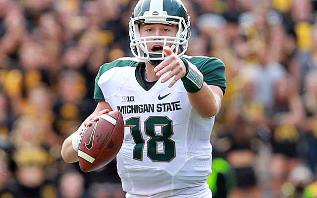Connor Cook has great size and mobility, but he needs to improve on his footwork and accuracy. (USATSI)