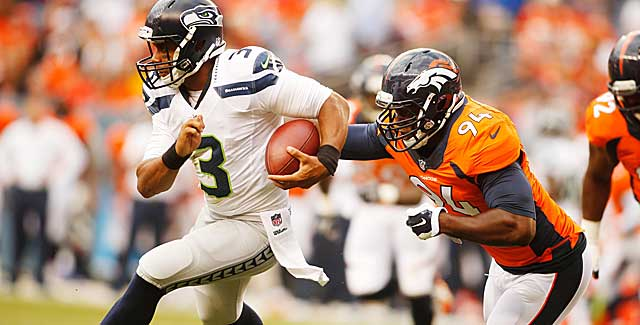 Already a presence DeMarcus Ware sacks Russell Wilson in Denver's preseason opener. (USATSI)