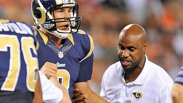 Sam Bradford's latest injury might force the Rams to draft a new franchise QB. (USATSI)
