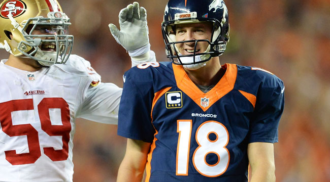 Manning breaks Favre's TD record with No. 509