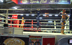 Two Muay Thai fighters -- 10 years old -- prepare for a bout in Fairtex Stadium. (Mike Freeman)
