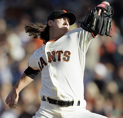 It's far from an easy outing for Tim Lincecum, who yields four hits and walks four despite giving up just a run in the W. (AP)