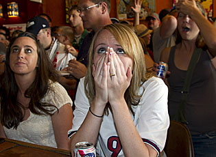 U.S. fans are stunned as they watch the last seconds of the Women's World Cup final in a Milwaukee pub. (AP)