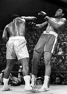Then champ Joe Frazier knocks down Muhammad Ali in the first of their three epic matches. (Getty Images)