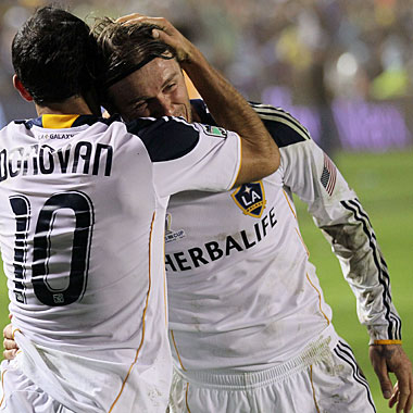 Landon Donovan, who scores the only goal, hugs David Beckham, whose five-year deal with the Galaxy ends. (Getty Images)