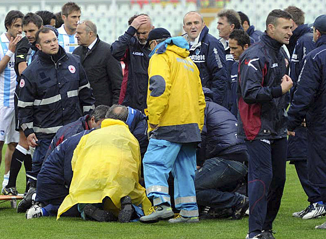 Medics work on Piermario Morosini as the Livorno midfielder lies on the turf Saturday. (AP)
