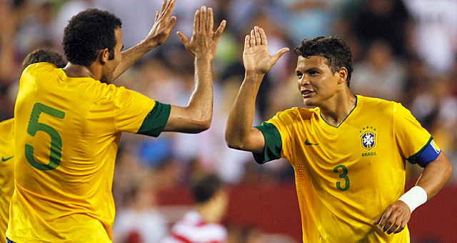 Thiago Silva (right) notches a goal as Brazil improves to 16-1 against the United States. (Getty Images)