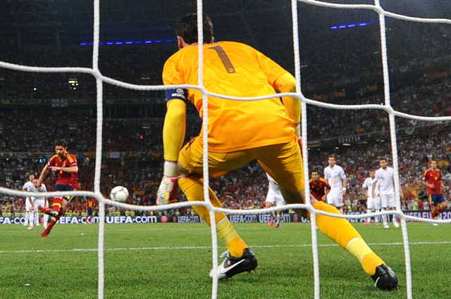 Spain's Xabi Alonso shoots and scores past French goalkeeper Hugo Lloris on a penalty spot. (Getty Images)