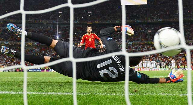 Spain's Cesc Fabregas scores the winning goal against Portugal goalie Rui Patricio in the penalty shootout. (AP)